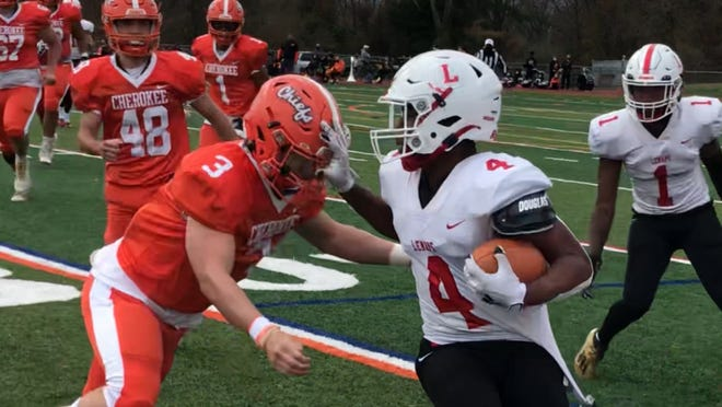 Lenape running back Kobi Ray-Reed fends off Michael Muckensturm of Cherokee as he tries to round the corner during Sunday's West Jersey Football League game.