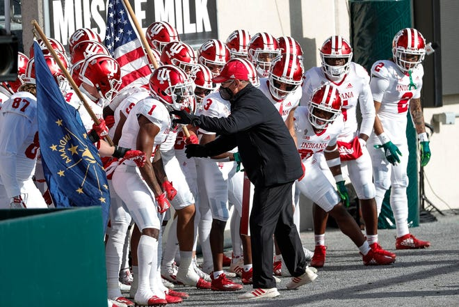 Coach Tom Allen fires up his Indiana players before they run onto the field for a game against Michigan State on Saturday.