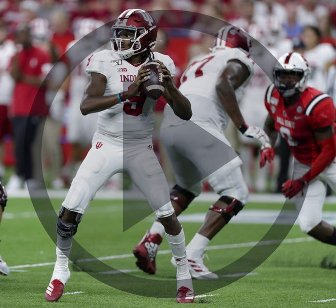 In this file photo, Indiana quarterback Michael Penix Jr. (9) throws against Ball State during the second half of an NCAA college football game in Indianapolis, Saturday, Aug. 31, 2019. Indiana defeated Ball State 34-24.