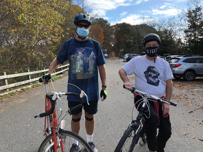 Jay Vivian, left, and Robin McMillan use the Cape Cod Rail Trail frequently. While some Wellfleet officials and residents are concerned about the potential dangers of extending the trail onto Route 6, Vivian said he is comfortable with the state's plan.