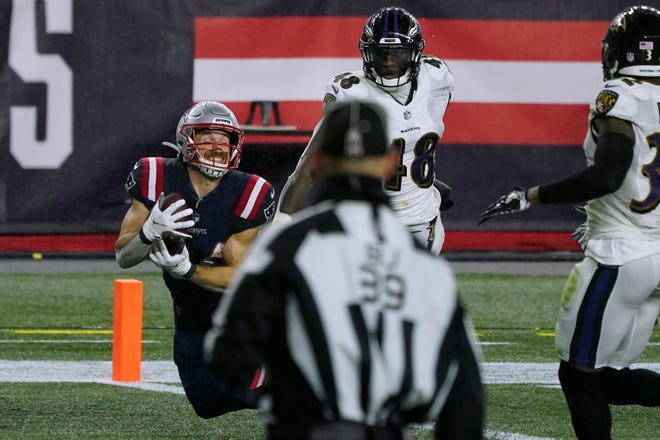 Patriots running back Rex Burkhead catches a touchdown pass thrown by wide receiver Jakobi Meyers against the Baltimore Ravens on Sunday.
