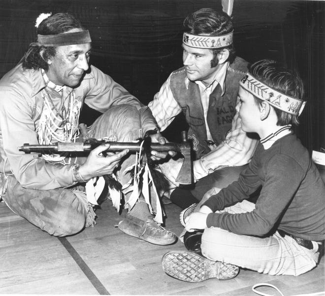 Frank James, left, of Chatham, Massachusetts, a member of the Aquinnah Wampanoag Tribe and then-president of the Federated Eastern Indian League, speaks with Neal Pratt, program director of the Cape Cod YMCA, and Patric Murphy in March 1972.