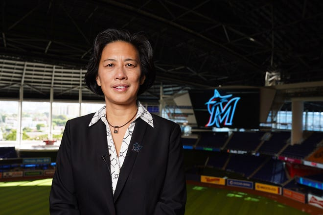 New Miami Marlins general manager Kim Ng poses for a photo at Marlins Park stadium before being introduced during a virtual news conference Monday.