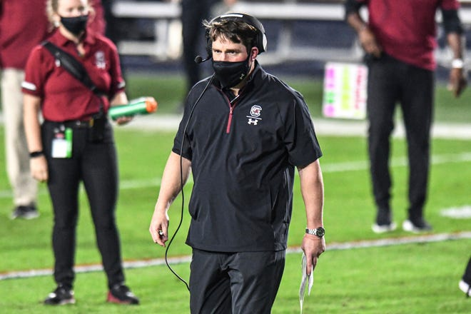 South Carolina head football coach Will Muschamp heads to check on an injured player during a game against Mississippi on Saturday in Oxford, Miss.