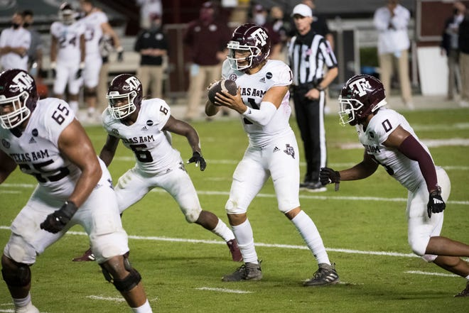 Texas A&M quarterback Kellen Mond (11) takes a snap during a game against South Carolina on Nov. 7 in Columbia, S.C.