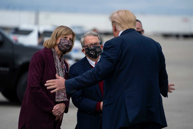 President Donald Trump talks to Ohio Gov. Mike DeWine and First Lady Fran DeWine after Trump arrived at Rickenbacker International Airport on Oct. 24 before a rally in Circleville. The DeWines did not attend the rally. Trump appeared to hint at a primary challenge for DeWine in a Tweet on Monday morning.