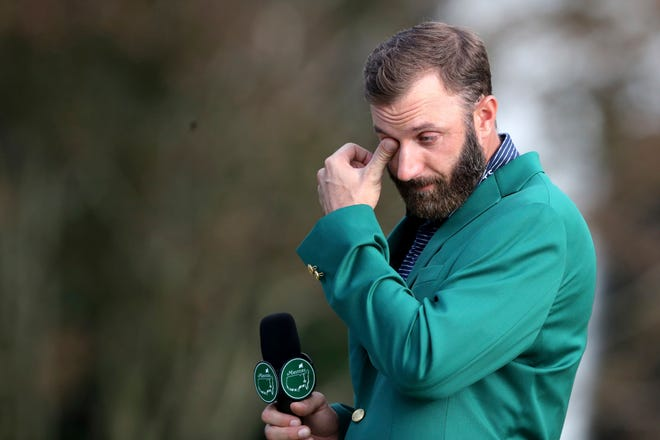 Dustin Johnson wipes away tears as he is interviewed after winning the Masters.