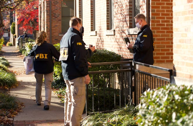 FBI agents remove items from the German Village home of Public Utilities Commission of Ohio Chairman Sam Randazzo in Columbus, Ohio on November 16, 2020.