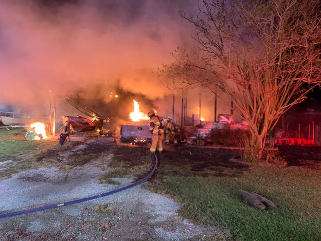The St. John Volunteer Fire Department battles a fire that erupted at 2410 W. Camelia Drive Monday in Thibodaux.