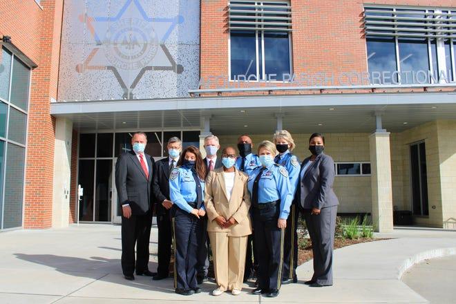From left in front, Lt. Carla Landry, Robbin Bell (ACA), Capt. Karla Beck; from left in back row, Sheriff Craig Webre, Fred Schoonover (ACA), David Eberhard (ACA), Maj. Cortrell Davis, Deputy Lesley Hill, Maj. Renee Brinkley.