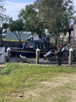 Terrebonne Parish Sheriff's Office Water Patrol deputies search for the Cessna T182T airplane that crashed Oct. 16 near Lake Hatch.