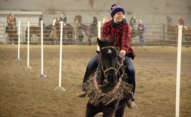 Brynley Coleman from Hatton, North Dakota rides Royal in an event. Coleman is a member of the Pirate girls' hockey team, playing as part of the school district's athletic cooperative agreement with Hatton Schools.