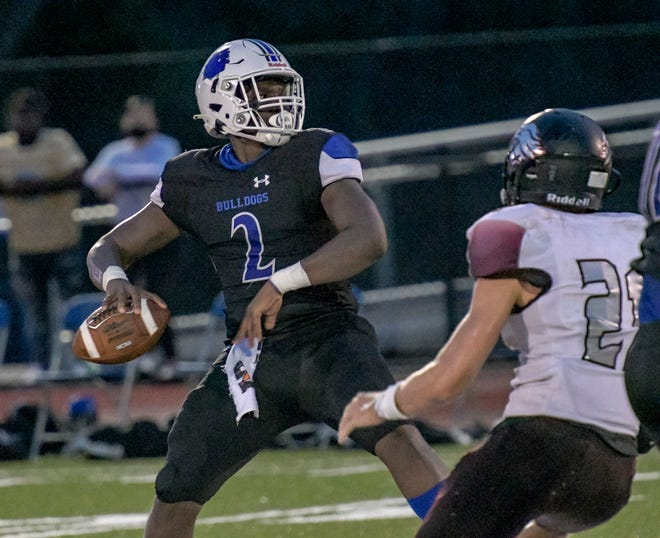 MDCA quarterback Tyquan Wiggins (2) gets set to pass against Orlando Faith Christian earlier this season. Wiggins will lead the MDCA offense against Orlando Christian Prep in Saturday's SSAC Class AAA championship game in Lakeland. [PAUL RYAN / CORRESPONDENT]