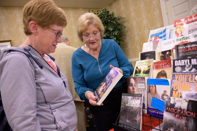 An author talks about her book at the Central Florida Book and Author Expo in The Villages on Sunday, Jan. 27, 2020.