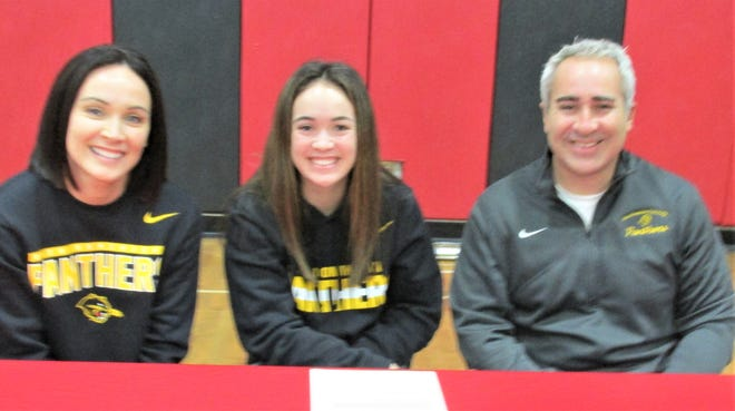 Cindy, Brynn and Thurman Mullet enjoy the moment at Hiland's signing celebration in November.