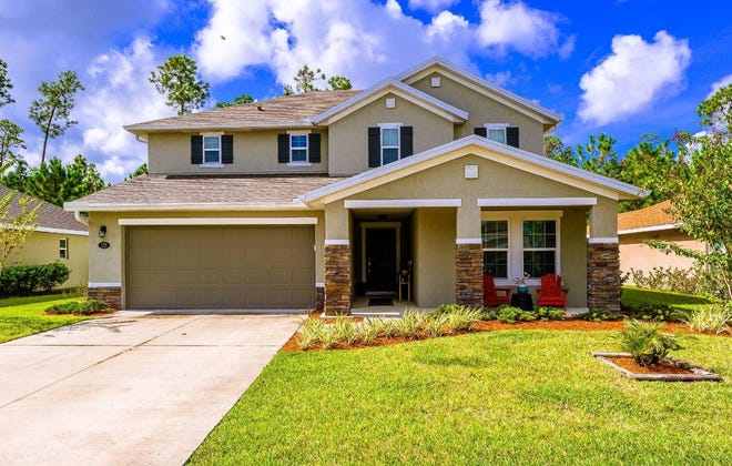 This airy two-story home in the Cypress Creek area of Hunters Ridge is an ideal blend of modern conveniences and gorgeous design.