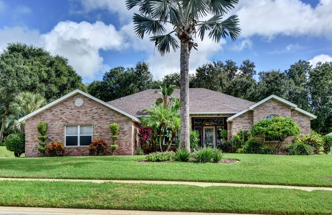 This open and airy pool home sits on a beautifully landscaped deep lot in the sought-after Port Orange community of Skylake.