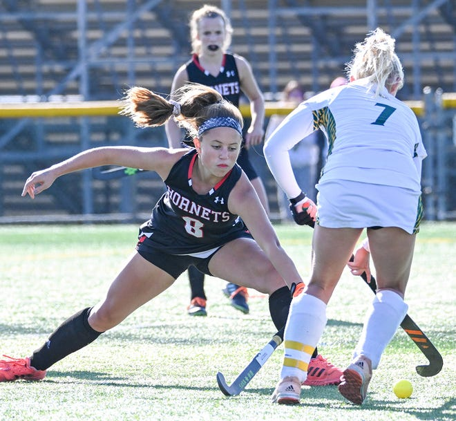 Junior captain Katy Corcoran (8) pokes the ball free Saturday afternoon at Emmaus in the Class AAA state semifinals.