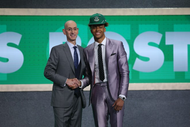 Romeo Langford (Indiana) greets NBA commissioner Adam Silver after being selected as the No. 14 overall pick to the Boston Celtics in the first round of the 2019 NBA Draft at Barclays Center.