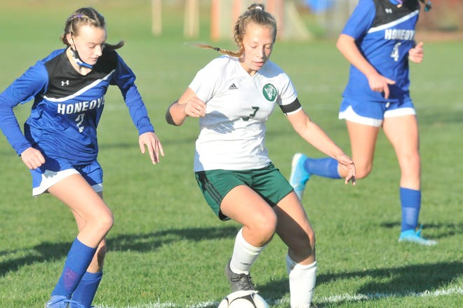 Genesee Valley's Adison Grusendorf (7) protects the ball against the defense of Honeoye's Ashley Thomas during Saturday's Class D1 match.