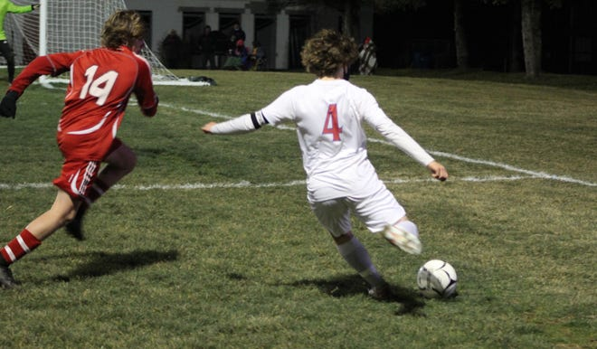 Hornell's Jonas Sciotti (4) sends one into the box against Pal-Mac on Saturday evening in the second round of the Section V Class B1 soccer tournament.