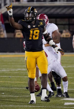 Missouri Tigers defensive lineman Trajan Jeffcoat (18) celebrates after a sack against Alabama earlier this season. Mizzou, in recent years, has not produced NFL line talent as it did under Gary Pinkel.