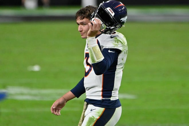 Denver Broncos quarterback Drew Lock (3) takes off his helmet after a play against the Raiders during the second half of an Sunday's game in Las Vegas. Lock, the former University of Missouri and Lee's Summit High School star, threw four interceptions in a 37-12 loss.