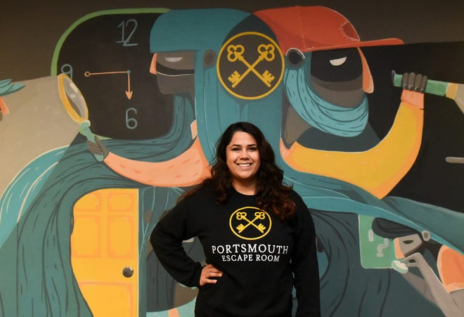 Javi Kalback, owner of Portsmouth Escape Room, pays her small team of employees above the minimum wage, saying it benefits her business to have happy employees.