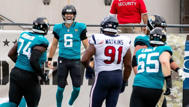 Jacksonville Jaguars quarterback Jake Luton (6) celebrates a rushing touchdown in the fourth quarter during the Jaguars vs. Texans game at TIAA Bank Field in Jacksonville, FL on Sunday, November 8, 2020. [Matt Pendleton/Special to the Times-Union]