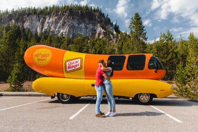 Hannah Fogus, who is living in St. Augustine, said yes when her boyfriend, Zach Chatham, proposed to her in Yellowstone National Park in front of the vehicle he's driving around the country for a year: the Wienermobile.