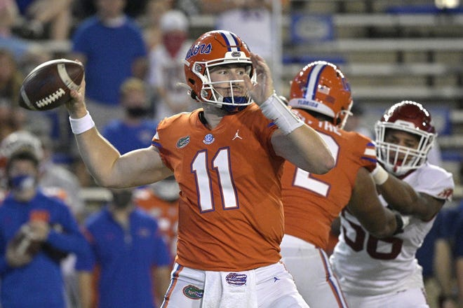 Florida quarterback Kyle Trask (11), seen here throwing a first-half pass against Arkansas, has risen from a Heisman Trophy long shot to being among the favorites for the coveted award.