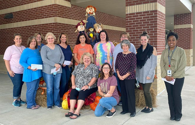 Pink Hill Elementary School led all schools in the three-county competition for Bright Ideas grants from Tri-County EMC with 13 grant awards. Shown with principal Lee Anne Hardy, seated left, are winners Allison Whitfield, kneeling, and, from left, front, Brenda Griffin, Jean Turner and Leigh Ann Hall and, back, Megan Lawson, Jami Finch, Julie Rouse, Amy Taylor, Stephanie Kollock, Selina Gray, Lindsey Lee and LaKresha Walston. Not pictured: Johan Mari Aviles.