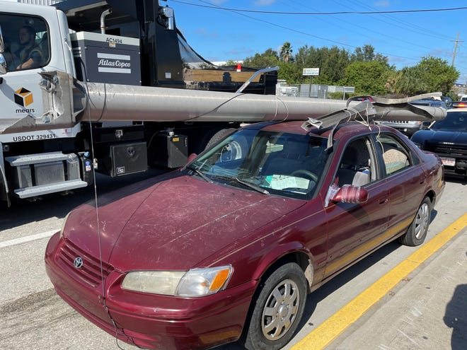 Florida Highway Patrol troopers, responding to a report of a stolen power pole on Interstate 4 on Monday, found this 1997 Toyota sedan with the utility pole strapped to the top of the vehicle.