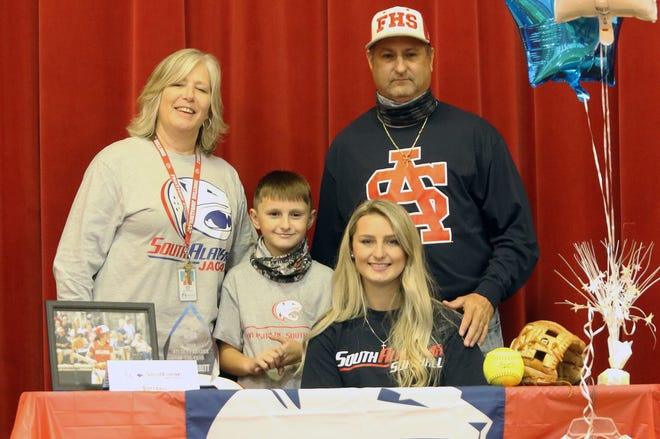 Frostproof senior Shelby Garrett signs with South Alabama for softball during a signing ceremony at Frostproof high school.