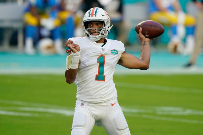 Miami Dolphins quarterback Tua Tagovailoa (1) looks to pass the football during the first half against the Los Angeles Chargers on Sunday in Miami Gardens.