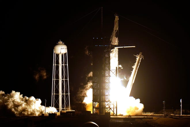 A SpaceX Falcon9 rocket, with the Crew Dragon capsule attached, lift's off from Kennedy Space Center's Launch Complex 39-A on Sunday in Cape Canaveral. Four astronauts are beginning a mission to the international Space Station.