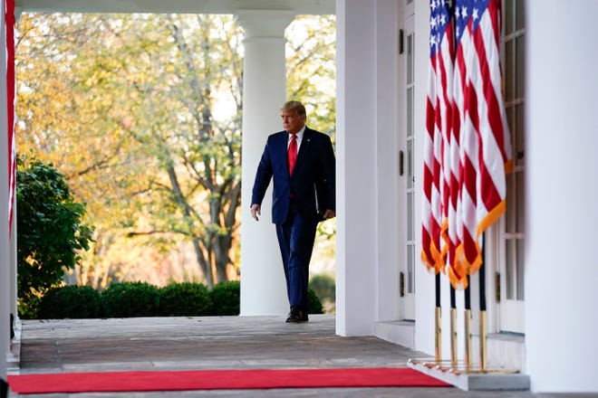 President Donald Trump arrives to speak in the Rose Garden of the White House on Friday in Washington.