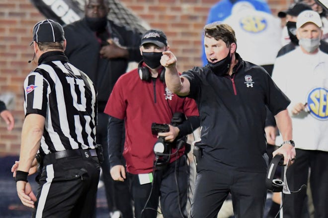 South Carolina head coach Will Muschamp yells at an official during the game against Mississippi Saturday in Oxford, Miss. Mississippi won 59-42.