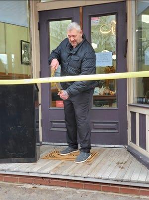 Bill Barham-Burns opens Scottsville Hair Studio on Main Street with a ribbon-cutting ceremony.