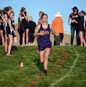 Eleanor Elliott-Rude had a strong senior season for the Nevada girls' cross country team in 2020. Elliott-Rude made all-HOIC with a sixth-place finish at the conference meet and she took 33rd at the 3A qualifying meet in Pella.