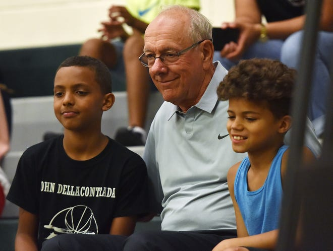 Syracuse University men's basketball coach Jim Boeheim, right, seen here at the King of Kings Summer Basketball League Monday, June 18, 2018 at Mohawk Valley Community College in Utica, recently tested positive for the novel coronavirus.