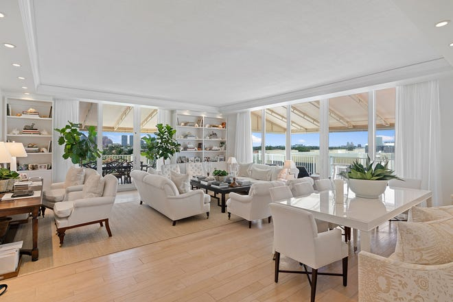 At the Lowell House facing Midtown Beach, Penthouse D's main living area has windows and terraces on two sides. The apartment is listed for sale at $3.549 million.