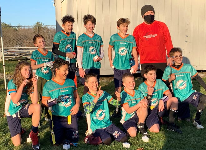 STRATHAM - The Portsmouth Dolphins defeated the Exeter Broncos, 30-24 on Saturday in the 11-,12-year-old championship game of the Seacoast Flag Football League. Pictured, front row, from left, Joe Lukacz, Josh Borgos, Iver Myles, Justin Maynard, Jesse Johnson and Caden Bancewicz. Back row, from left, Parker Brewster, Andre Ronaldson, Andy Brown, Kenny Avery and coach Ken Avery. Missing from photo, Joe Berry.