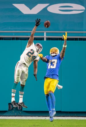 Dolphins cornerback Byron Jones deflects a pass intended for Los Angeles Chargers receiver Keenan Allen.