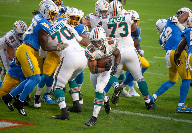 Dolphins running back Salvon Ahmed scores on a 1-yard run on Miami's first play from scrimmage Sunday against the Chargers.