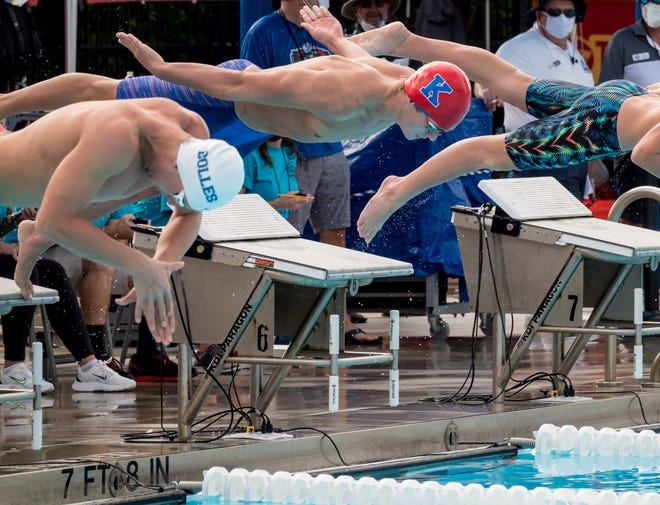 Bolles swimmer Andres Dupont Cabrera (left) launches off the blocks first on his way to victory in the boys 200-yard freestyle. Bolles extended its dominant run in both boys and girls swimming this year.