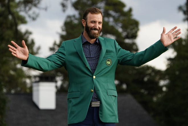 Masters champion Dustin Johnson shows off his green jacket after winning the tournament Sunday in Augusta, Ga.
