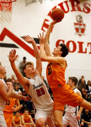 Crater's Nate Bittle is fouled by Thurston's Mason Miller on a drive to the basket during a Jan. 25, 2019, game at Thurston. [Andy Nelson/The Register-Guard]
