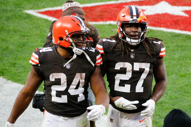 Browns running backs Nick Chubb (24) and Kareem Hunt (27) walk off the field after the Browns defeated the Houston Texans 10-7 at FirstEnergy Stadium in Cleveland on Nov. 15. [Ron Schwane/Associated Press]
