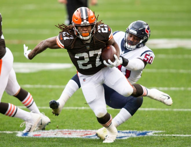 Cleveland Browns running back Kareem Hunt breaks a tackle from Texans linebacker Tyrell Adams during the first quarter Nov. 15 in Cleveland. Hunt and Nick Chubb are a formidable rushing combination that the Philadelphia Eagles will have to contend with on Sunday. (Scott Galvin-USA TODAY Sports)